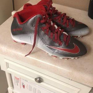 Brand new size 11 football cleats with gloves